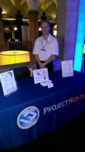 Ron l. manning the Project Hosts table at the Midwest SharePoint and Project Conference